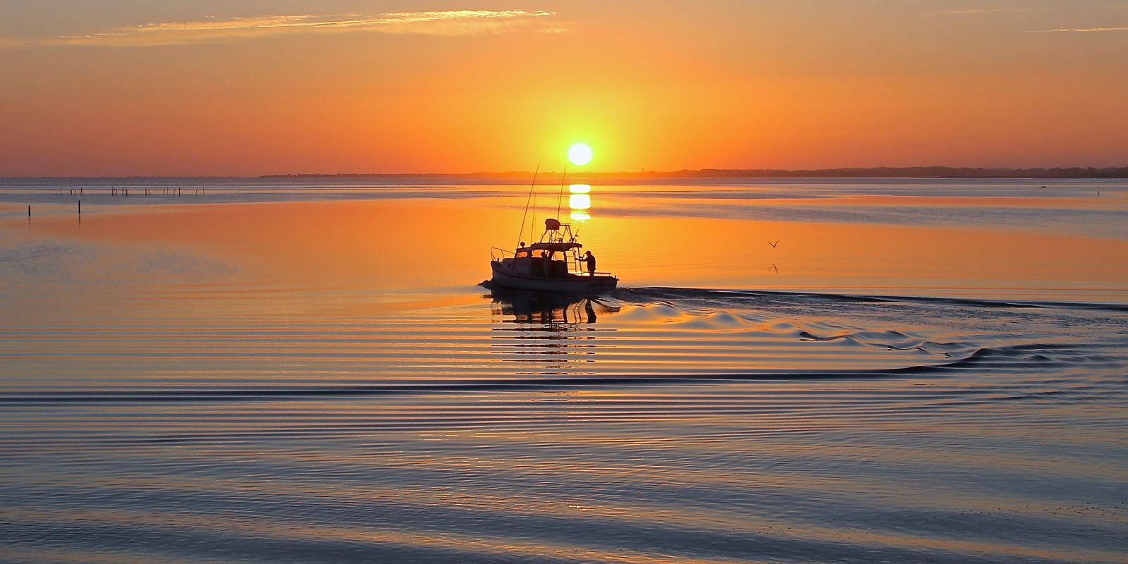 Boat and sunset on Hatteras Island