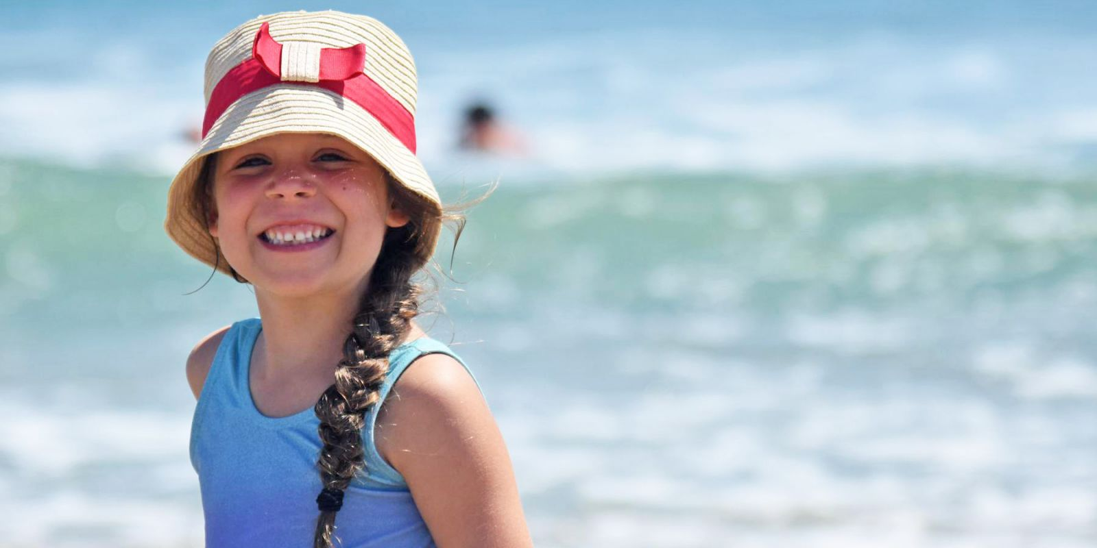 Girl in a Hat on Hatteras Beach