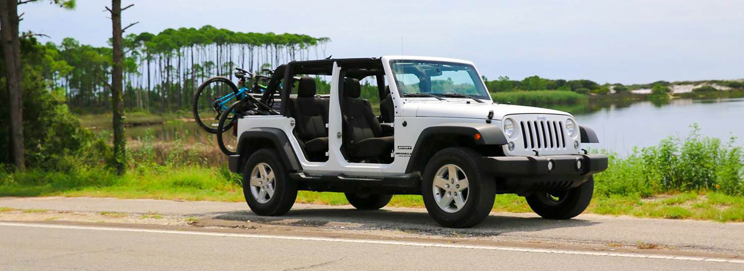 Jeep with Bikes on the Back: Discount Jeep Rentals Banner