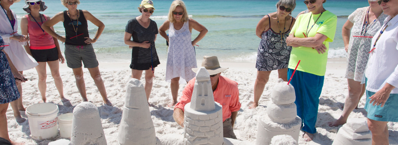 Family Building a Sandcastle at Lessons in Destin