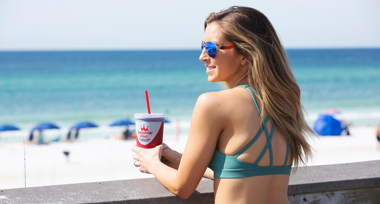 Woman Drinking Smoothie on Beach in Destin